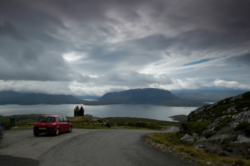 A Car Travels Along The A896 Through The Beinn Eighe Nature Reserve