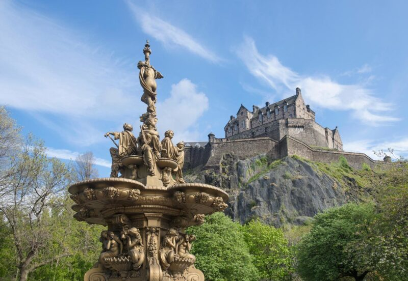 Edinburgh Castle And Ross Fountain In Princes Street Gardens
