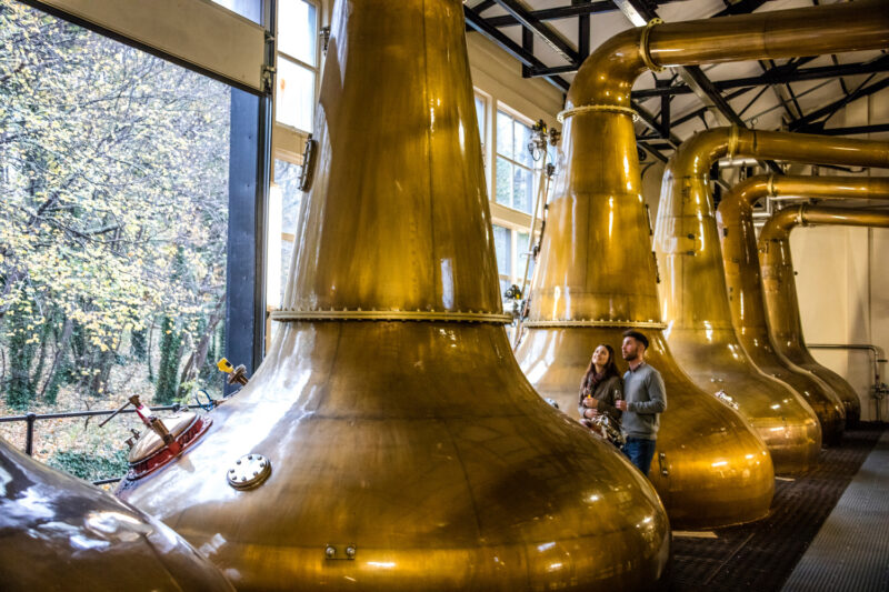Glen Ord The Nearest Distillery To Inverness Loch Ness In The Highlands Of Scotland  A Couple Standing Next To The Copper Stills
