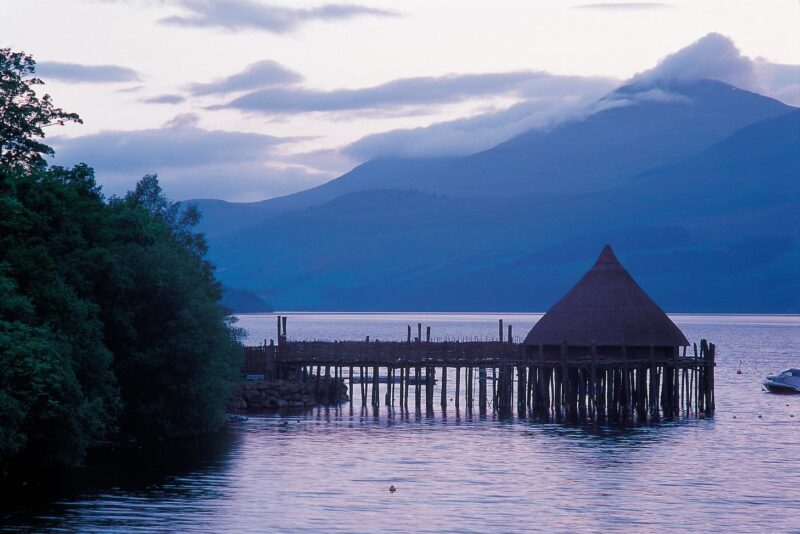 Looking Along The Shoreline Of Loch Tay To The Scottish Crannog Centre At Kenmore Perth And Kinross