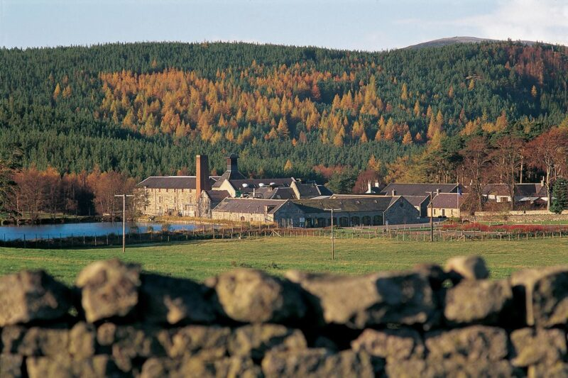 Looking Over A Dry Stone Wall To The Royal Lochnagar Whisky Distillery