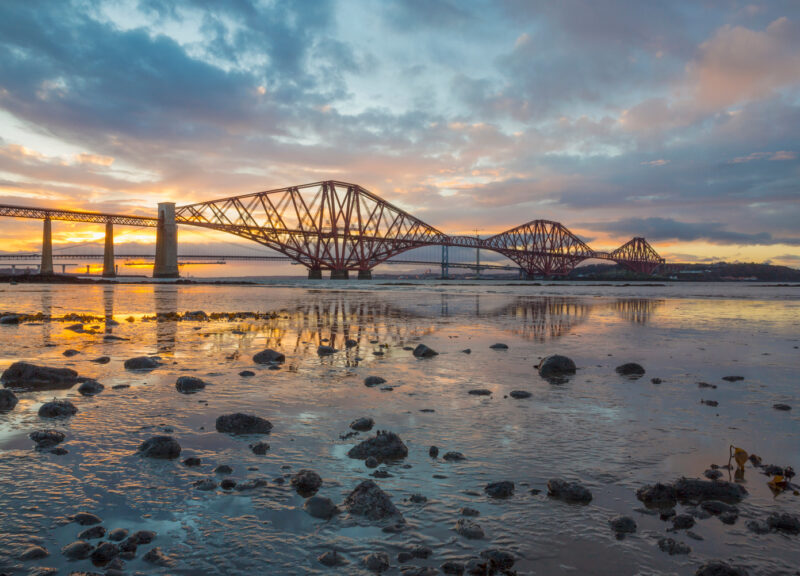 The Forth Bridge In South Queensferry At Sunset