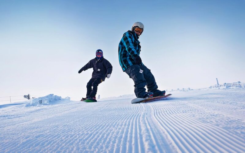 Two Snowboarders Enjoying The Lecht Pistes